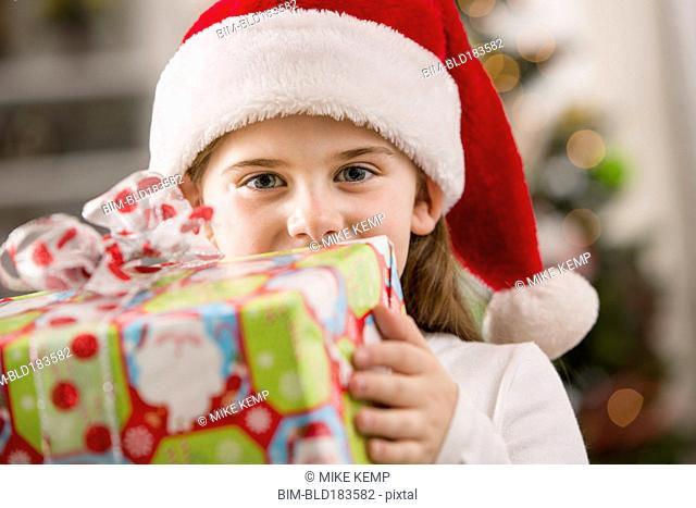 Caucasian girl holding Christmas gift