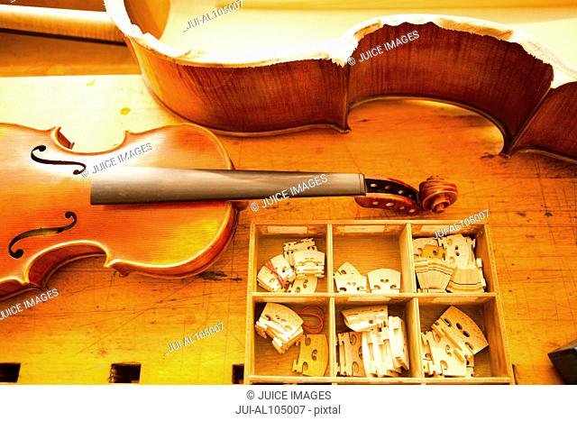 Parts of a violin being made