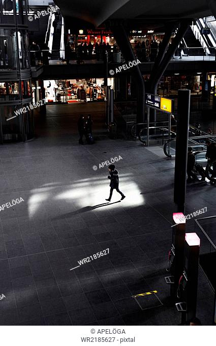 High angle view of woman walking in shopping mall
