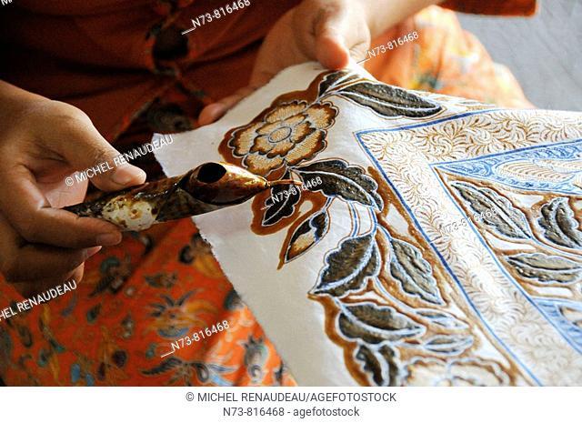 Woman making 'batik' manual wax-resist dyeing, Bali, Indonesia