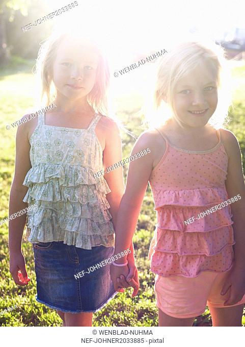 Girls holding hands