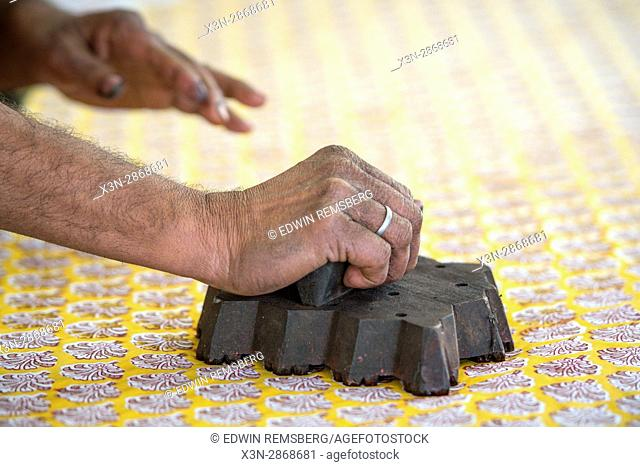 Jaipur, India - Indian man stamping pattern