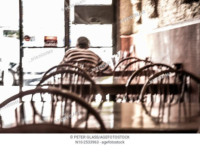Man sitting at a table in a restaurant