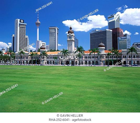 The city skyline from Merdeka Square with the Sultan Abdul Samad Building and Petronas Towers in the centre of Kuala Lumpur, Malaysia, Southeast Asia, Asia