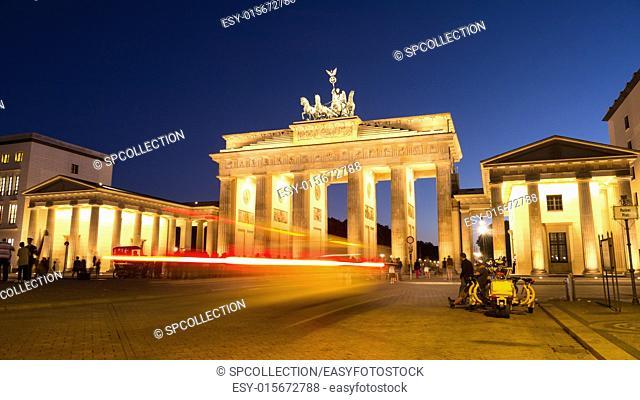 car light at brandenburger tor in berlin in evening