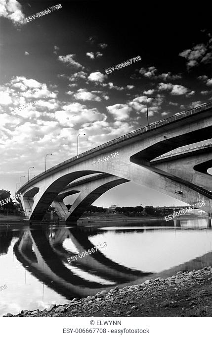 Architecture of bridge with reflection in river and beautiful sky