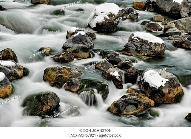 Fresh snow, boulders and rapids in the Gardner River