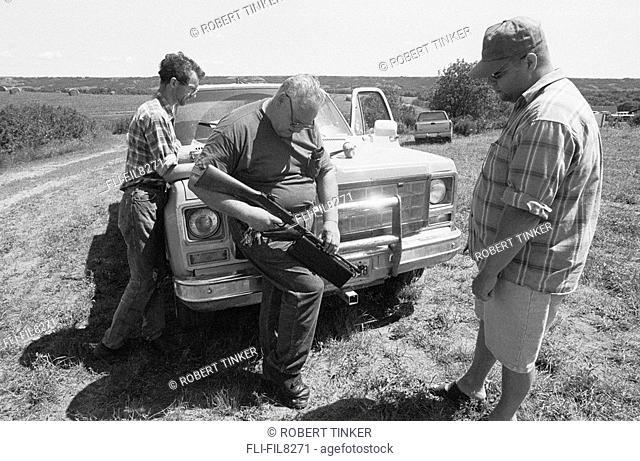 Collector Adjusts his Thompson Submachine Gun, MG 98 Machine Gun Festival, Virden, Manitoba