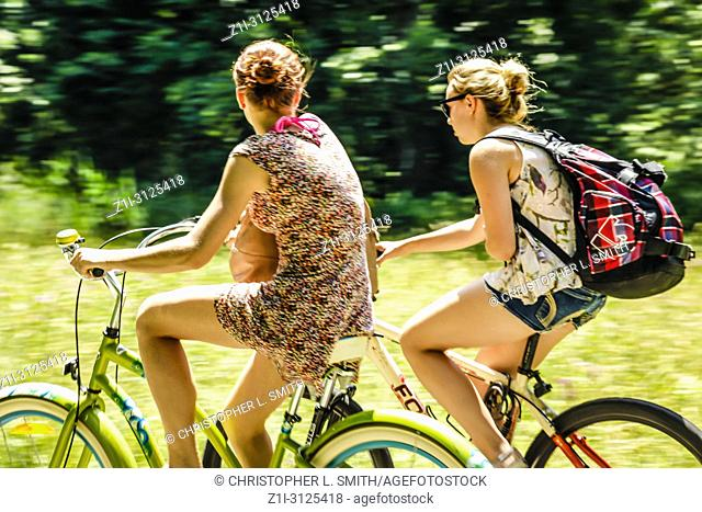 People enjoying a leisurely bicycle ride in rural Austria on a summer's day