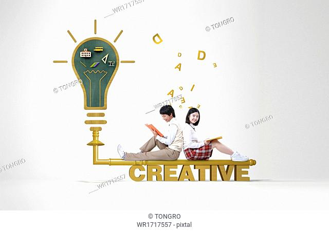 Two students sitting on the word creative