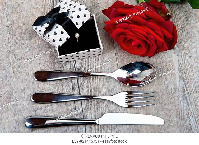 cutlery, rose and gift for Valentine's Day