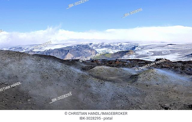 View across new lava fields created by a volcanic eruption in 2010 to the Myrdalsjökull glacier, at the long-distance hiking trail from Skógar via Fimmvörðuhals...