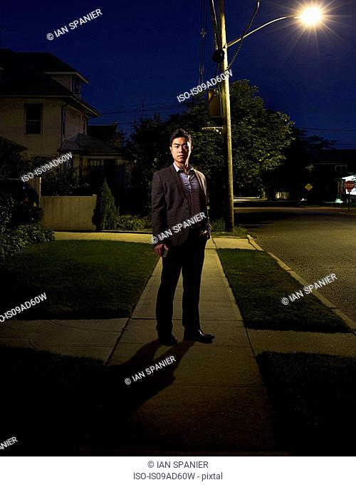 Portrait of business man coming home late at night