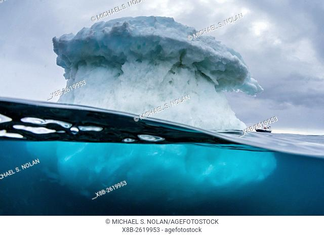 Above and below water view of the National Geographic Explorer, Brown Bluff, Antarctica