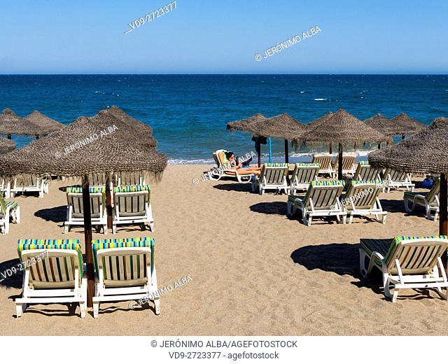 Straw umbrellas & Hammock, beach, Fuengirola. Malaga province Costa del Sol. Andalusia southern, Spain Europe