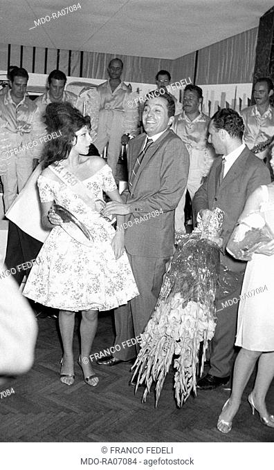 Italian actress Stefania Sandrelli winning a miss sash during a beauty competition in a club somewhere in Versilia. Italy, 1960