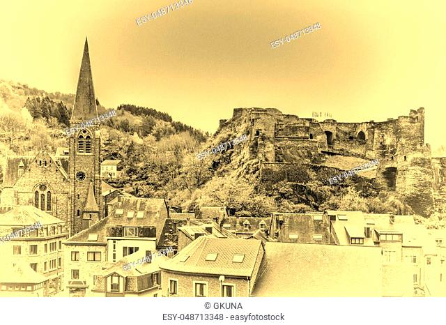 View of the Church and the Castle in the Belgian City of La Roche. View of the town centre below its medieval Castle in of La Roche
