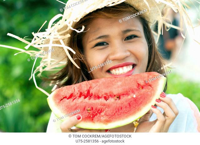 Young Asian woman with water melon, on location, Cebu, Philippines