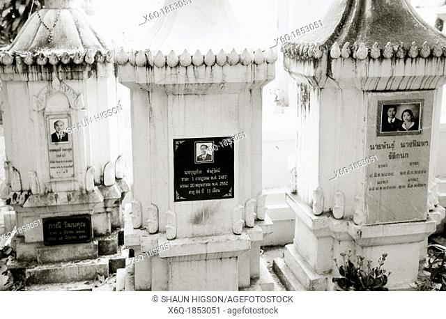 Gravestones in a cemetery in Chiang Mai in Thailand in Southeast Asia Far East