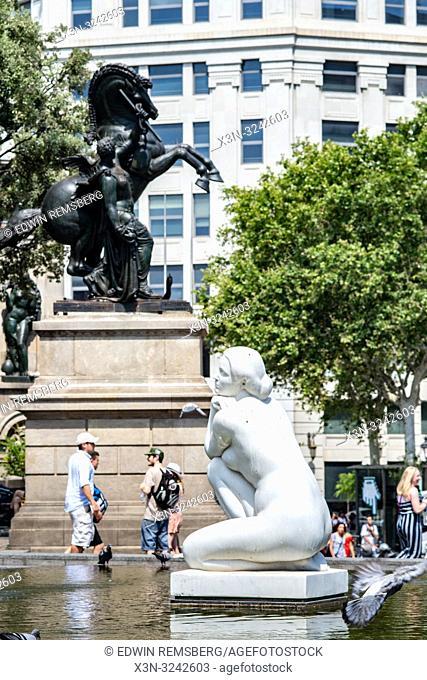Two fountain sculptures in Plaa de Catalunya in Barcelona ,Spain