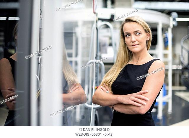 Portrait of confident woman in factory shop floor
