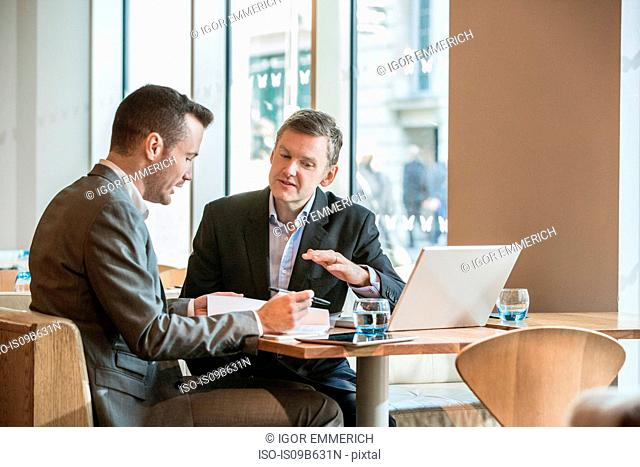 Businessmen working in cafe