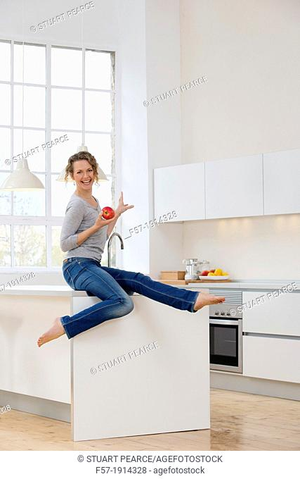 Healthy young woman in her kitchen