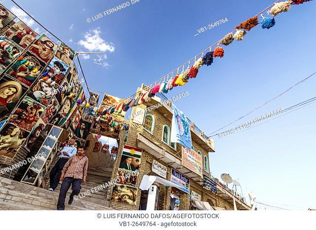 Shop displaying tapestries whith Christian, Muslim and nationalist motifs. Erbil, Kurdistan Region, Iraq