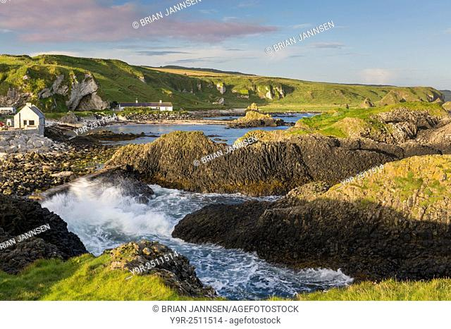 Early morning on the rocks overlooking Ballintoy, County Antrim, Northern Ireland, UK