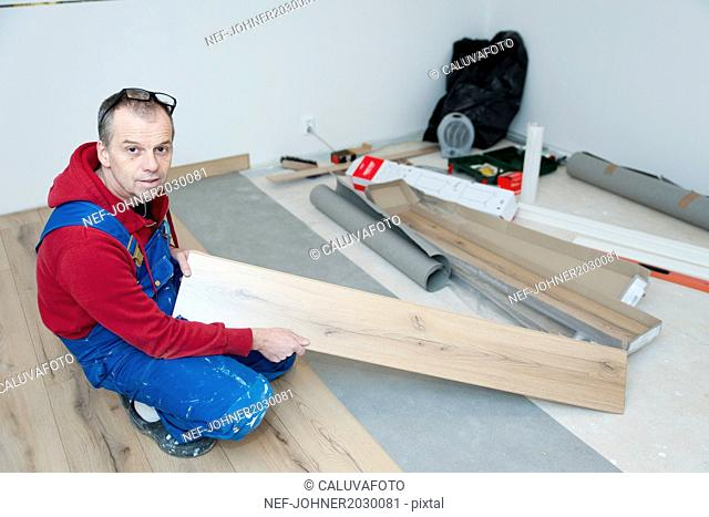 Man lying laminate floor