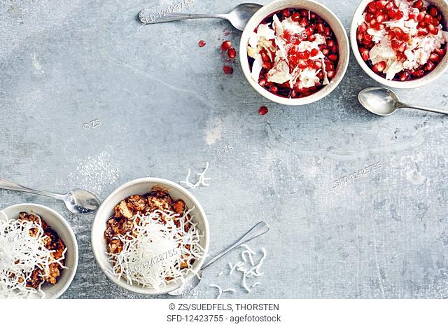 Chocolate ice cream topped with glass noodles, and coconut ice cream with pomegranate