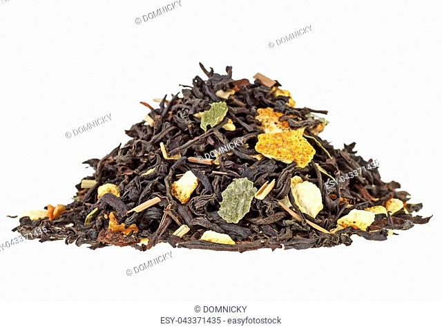 Pile of aromatic dry tea with fruits on white background. Orange fruit and lemon grass