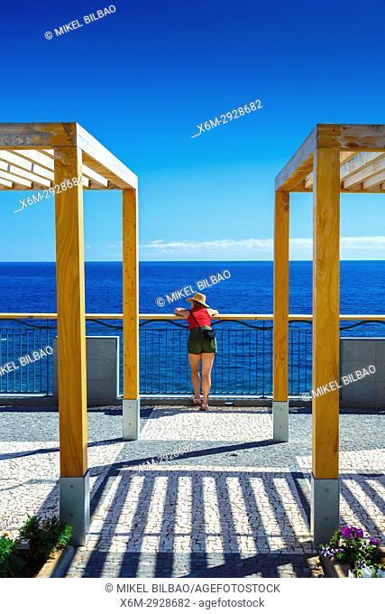 Woman in a balcony. Calheta (Paul do Mar). Madeira, Portugal, Europe