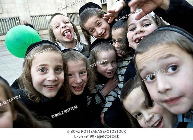 Orthodox Jewish boys having fun with the camera in the religious neighborhood of Mea Shearim in Jerusalem