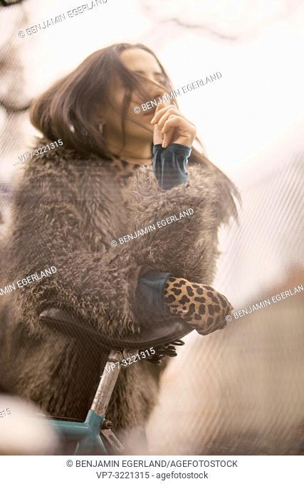 portrait of sensual woman wearing fashionable coat, in Munich, Germany