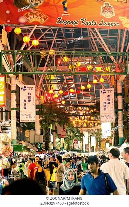 shopping crowd in chinatown night market of kuala lumpur, malaysia. One of the tourist's attractions