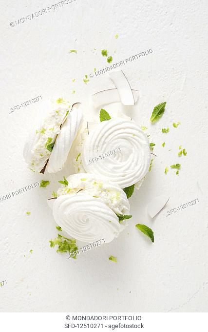 Meringue sandwiches with coconut ice cream, peppermint and lime