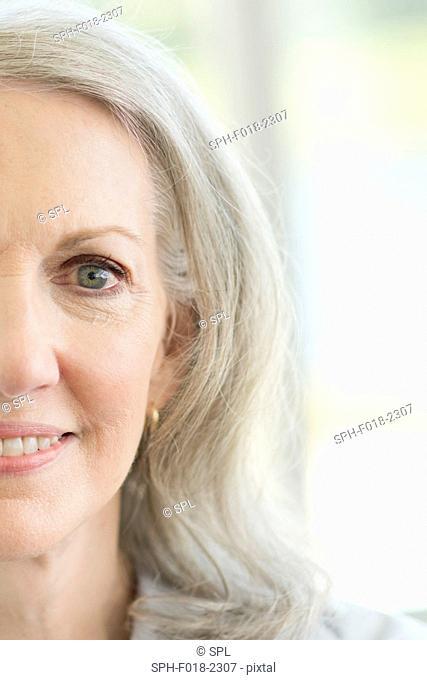 Senior woman smiling, close up