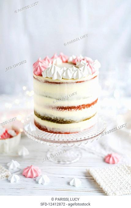 Cranberry vanilla layer cake with a meringue wreath