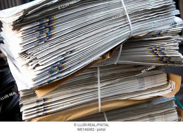 Close up of newspapers bundle