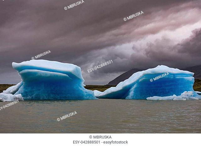 famous and beautiful glacier structure on lagoon fjallsarlon in iceland with blue icebergs