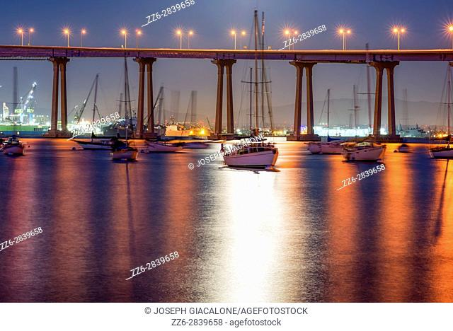Moonlight on San Diego Harbor with a view of the Coronado Bridge. Coronado, California, USA