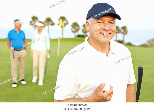 Smiling senior man on golf course