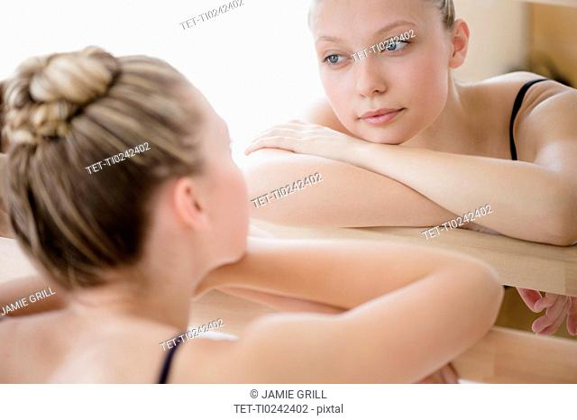 Portrait of teenage (16-17) ballet dancer and her reflection in mirror