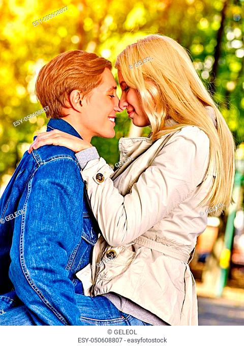 Spring couple walking park and kissing. Summer friends walk outdoor. First date and kiss of two young people in good weather day