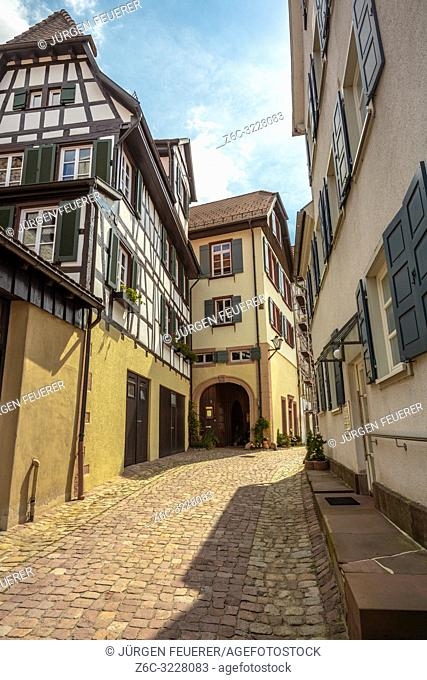 narrow lane with half-timbered houses and pavement, Black Forest, Germany, town Schiltach in the Kinzig valley