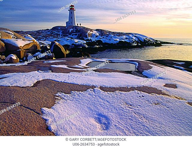 Peggy's Cove Lighthouse in winter with snow, Nova Scotia, Canada