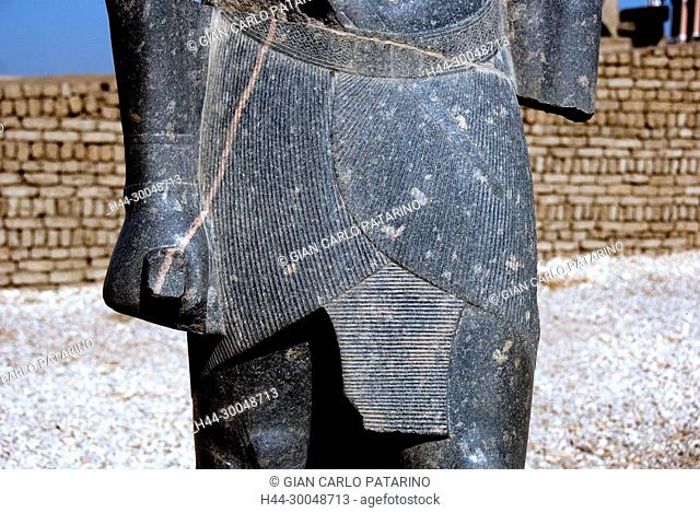 Luxor, Egypt. Temple of Luxor (Ipet resyt): a statue of the king Merenptah showing the kilt named shendit
