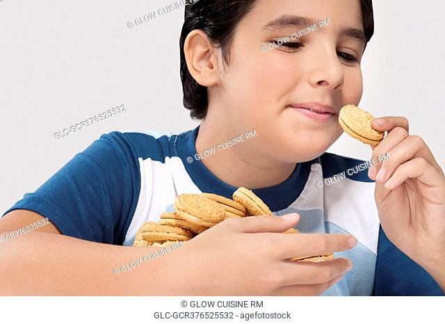 Close-up of a boy eating a cookie