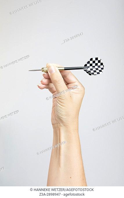 Hand holding darts